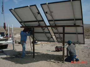 Worker's setting up Solar Panel Array